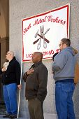 SACRAMENTO, CALIFORNIA - FEBRUARY 26: Members of Sheet Metal Workers Union recite Pledge of Allegian