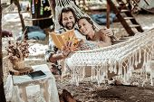 Smiling Couple Of Hippies Relaxing In Park poster