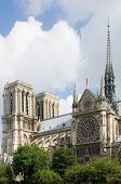 A detail of the Notre Dame, Paris, France with the sunlight striking the towers of this majestic cathedral and tourist attraction. The famous landmark is located on Ile de La CitŽ poster