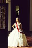 Small Girl Kid With Long Blonde Hair And Pretty Happy Smiling Face In Prom Princess White Dress And  poster