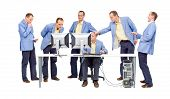 stock photo of dtp  - Several people mingling with the work of one guy on the computer - JPG