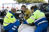 picture of sidecar  - paramedic covers a patient with a blanket to protect her from the cold - JPG