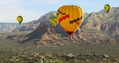 A Hot Air Balloon Foursome Soars Above The Red Rocks Of Sedona, Arizona, Usa poster