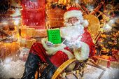 Santa Claus is preparing for Christmas, he reads a book with childrens desires. House of Santa Clau poster