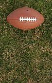 image of football field  - Football on grass with room for copy - JPG