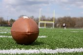 picture of ncaa  - Football on a field - JPG