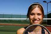 Smiling Female Tennis player with room for copy