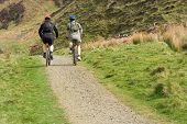 tourists, cycle trip in scottish highlands, bikers, outdoor activity