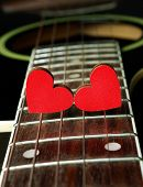 Red Hearts On The Strings Of A Guitar. Hearts Are A Symbol Of Love. Strings Of The Heart. poster