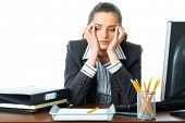 young attractive tired, overworked and exhausted female office worker in grey suit, isolated on whit