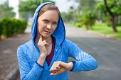 Confident Young Female Athlete Checking Pulse With Smartwatch. Portrait Of Caucasian Woman Taking Pu poster