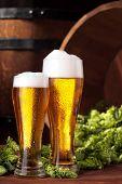 Beer .two Mug Of Beer.beer With Hops.advertising Of Beer.barrel And Scattered Hops On Backgorund. poster