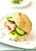 Sandwich with ham, lettuce, cucumber and tomato served on a plate. Home made food. Symbolic image. C poster