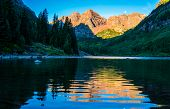 Golden Hour Sunrise Perfect View Of Infamous Maroon Bells Wilderness Reflections Off Rippling Waters poster