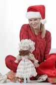 Cute Girl With Doll For Christmas poster
