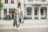 Woman In Trend Multilayered Outfit Walks In Autumn City Street. Fashion Street Trends poster