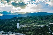 Awesome Sky With White Clouds. Aerial Panoramic View Of Cityscape. Beautiful Panorama Of Green Trees poster