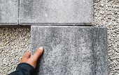 Paving Blocks. Hand Holds And Install Paving Block poster
