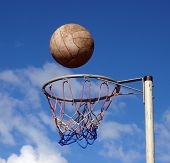 foto of netball  - Ball ready to drop through the hoop - JPG