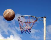 stock photo of netball  - Net Ball just before hitting the rim of the hoop - JPG