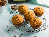 Pumpkin Whole Wheat Muffins For Breakfast On Turquoise Background poster