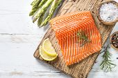 Salmon Fish. Uncooked Salmon Fillet With Ingredients For Cooking -  Fresh Vegetables And Spices On W poster
