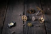 Old Watches, Clockwork - Gears, Screws, On Wooden Boards. Good Idea Vintage, Time From The Inside. poster