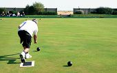picture of crown green bowls  - A bowler playing on the village green - JPG