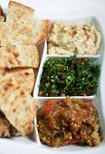 stock photo of tabouleh  - Traditional Arab or Mediterranean mezze with Turkish flat bread - JPG