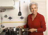 Senior Woman Cooking poster