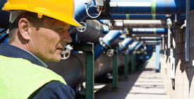 picture of retarded  - Maintenance engineer at the waste water management system of a huge factory - JPG