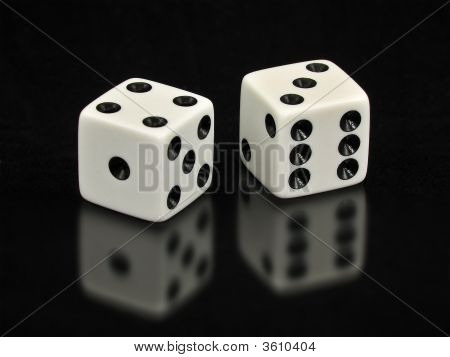 Lucky Sevens White Dice Isolated On Black Background With Reflection