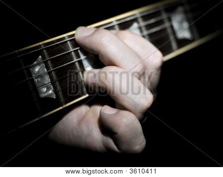 Guitar Player Fingering Chords On Fretboard
