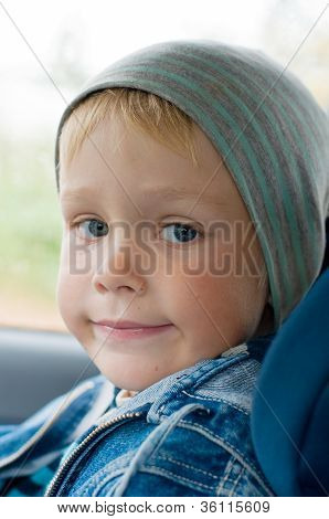 Five Year Old Boy In A Child Car Seat.
