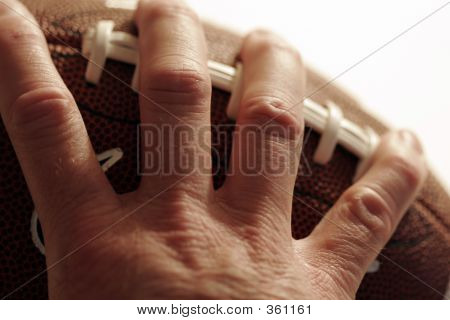 Hand Holding American Football