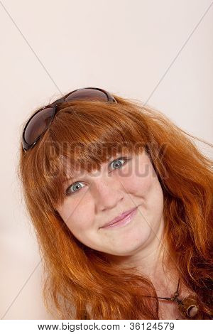 Headshot Of Cheerful Redhead