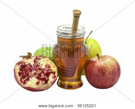 pomegranate, apples and honey isolated on white background