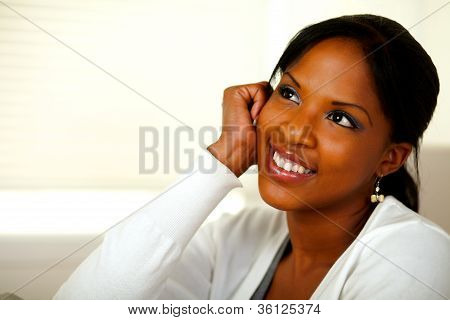 Pensive Young Black Woman Looking Up