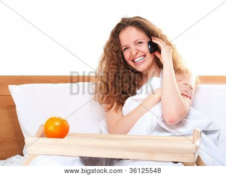 Woman In Bed Talking By Phone With Orange On Tray
