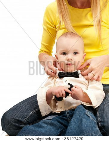 Mom Adjusting Bow Tie For Her Baby