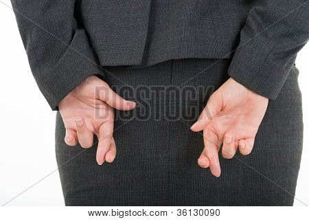 Business Woman Holding Crossed Fingers Behind Back