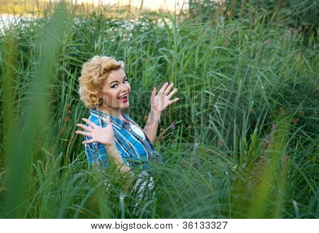 Beautiful Happy Surprised Pinup Girl In Grass