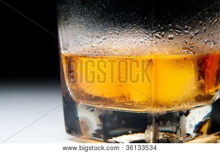 Closeup Macro Misted Heavy Glass Of Whiskey