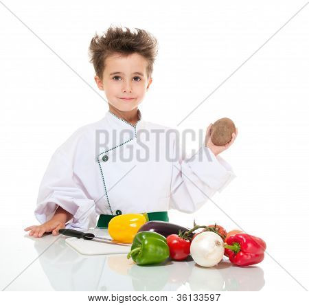 Little Boy Chef In Uniform With Knife Cooking Vegatables Holding Potato