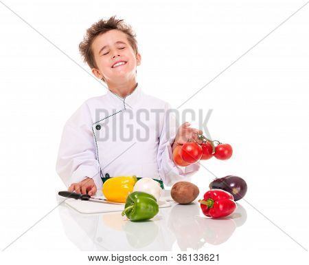 Little Boy Chef In Uniform With Knife Cooking Vegatables Holding Bunch Of Tomatoes