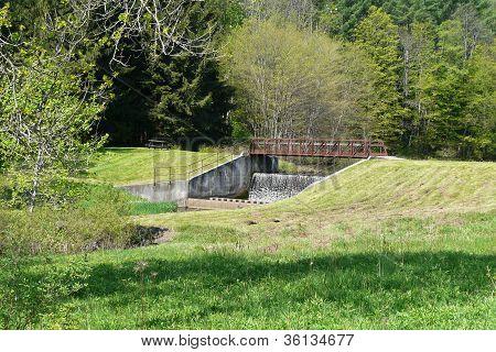 small dam bridge over creek
