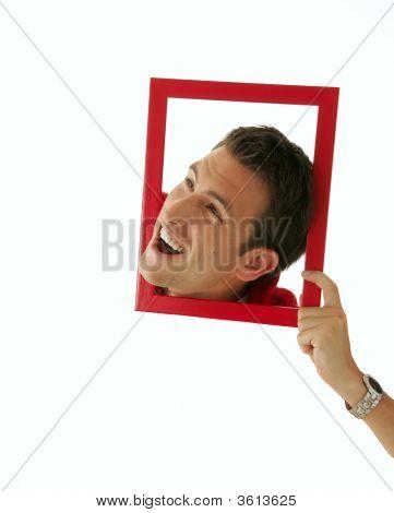 Man'S Head In A Frame.
