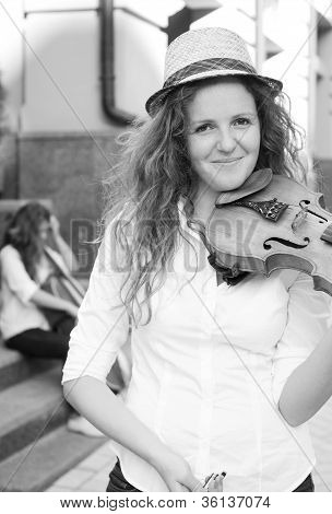 Woman From Strings Duet Playing Violin On The Street