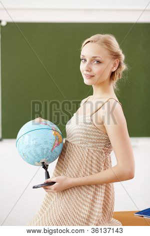 Teacher at school with a globe