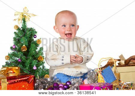 Laughing Baby Surrounded By Christmas Gifts